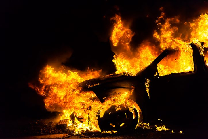 Car in fire, burning at night